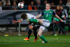 HANOVER, GERMANY - OCTOBER 11:  Joshua Kimmich (L) of Germany and Shane Ferguson of  Northern Ireland compete for the ball  during the FIFA 2018 World Cup Qualifier between Germany and Northern Ireland at HDI-Arena on October 11, 2016 in Hanover, Germany.  (Photo by Joern Pollex/Bongarts/Getty Images)