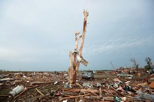MOORE, OK - MAY 20: Debris covers the ground after a powerful tornado ripped through the area on May 20, 2013 in Moore, Oklahoma. The tornado, reported to be at least EF4 strength and two miles wide, touched down in the Oklahoma City area on Monday killing at least 51 people. (Photo by Brett Deering/Getty Images)