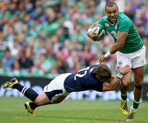 Within reach: Ireland's Simon Zebo is pursued by Peter Horne at the Aviva Stadium
