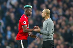 Paul Pogba shakes hands with Pep Guardiola