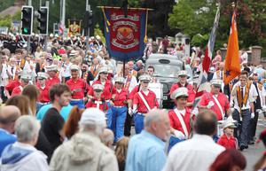 Belfast's Orange Order annual 12th of July demonstration makes its way through the City Centre to the field at Malone House beside Shaws Bridge.  The parade makes its way up Malone Road.