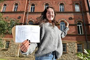 Pacemaker Press 20-08-2020:  Student Charlotte Rose Tucker pictured celebrating her GCSE success at St Dominic's Grammar School Belfast .There has been a significant rise in the number of top GCSE grades in Northern Ireland. Grades A*-A were awarded to 37.1% of entries, up from just under a third of entries in 2019. Picture By: Arthur Allison/ Pacemaker Press.