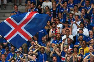 Iceland fans cheer during Euro 2016 round of 16 football match between England and Iceland at the Allianz Riviera stadium in Nice on June 27, 2016.   / AFP PHOTO / PAUL ELLISPAUL ELLIS/AFP/Getty Images