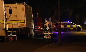 Police and ATO at the scene of a security alert on the Lurgan Road in January. Pic Colm Lenaghan/Pacemaker