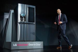 LG Electronics' Vice President of Marketing David VanderWaal presents the LG InstaView Door-in-Door smart refrigerator at the LG press conference at the 2017 Consumer Electronics Show (CES) in Las Vegas, Nevada on January 4, 2017.  / AFP PHOTO / DAVID MCNEWDAVID MCNEW/AFP/Getty Images