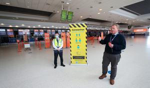 Managing Director, Graham Keddie (right), gives the media a tour of covid-19 measures at  Belfast International Airport which reopens on Monday June 15th. Niall Carson/PA Wire