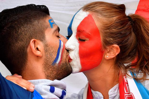 The beautiful game - football fans from around the world - France supporters kiss prior to the Euro 2016 semi-final football match between Germany and France at the Stade Velodrome in Marseille on July 7, 2016.