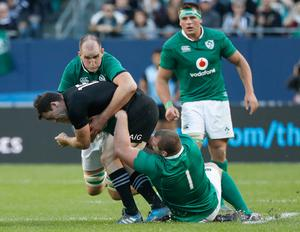 Ireland's Devin Toner, back, and Jack McGrath, right, defend against New Zealand's Ben Smith, center, during the second half of a rugby match Saturday, Nov. 5, 2016, in Chicago. (AP Photo/Kamil Krzaczynski)