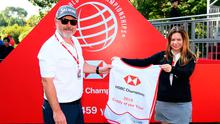 "Brian ""Bo"" Martin is presented with the Caddy of the Year bib at the WGC HSBC Champions."