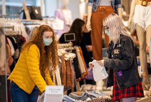 Caitlin Lynch (right) and Anna Kirkwood wearing face masks as they browse in Stradivarius in Belfast City Centre. Photo credit: Liam McBurney/PA Wire