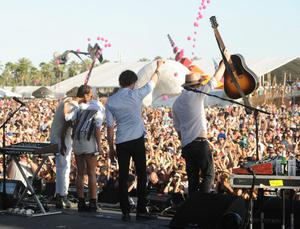 INDIO, CA - APRIL 12:  (L-R) Musicians Joshua Winstead, Emily Haines, Joules Scott-Key and James Shaw of the band Metric perform onstage during day 1 of the 2013 Coachella Valley Music & Arts Festival at the Empire Polo Club on April 12, 2013 in Indio, California.  (Photo by Kevin Winter/Getty Images for Coachella)
