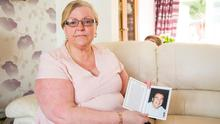 Eleanor King with a picture of her brother Andrew Kearney. (Photo by Kevin Scott / Belfast Telegraph