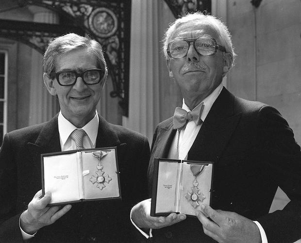 Comedy script writing partners Denis Norden and Frank Muir display their CBE's at Buckingham Palace (PA archive)