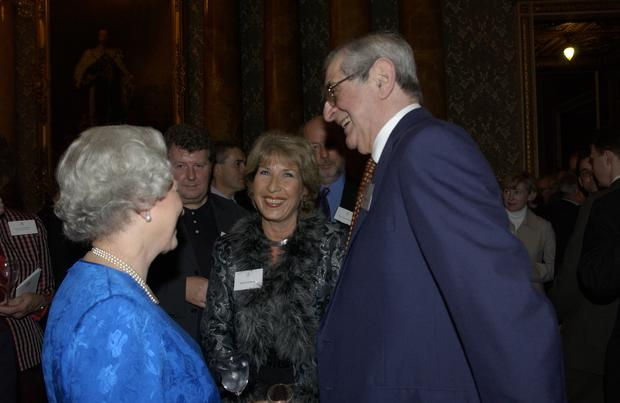 The Queen with Royal correspondent Jennie Bond and Denis Norden at a reception for the British broadcasting industry in Buckingham Palace (PA)
