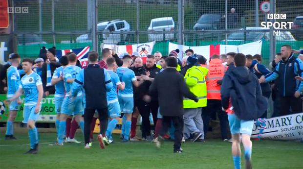 Warrenpoint Town and Ballymena United brawl as the Irish Cup tie at Milltown ends in melee. Credit: BBC