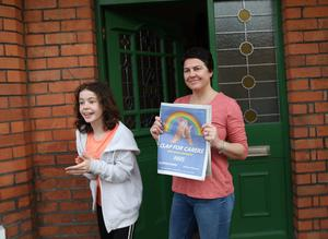 Emma McWIlliams and daughter Emily hold the Belfast Telegraph Clap for the Carers poster in East Belfast . Photo by Peter Morrison