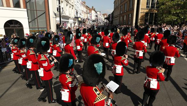 On parade: A marching band performs ahead of the wedding (John Sibley/PA)