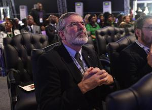 Sinn Fein President Gerry Adams waits for the funeral service for former South African president Nelson Mandela in Qunu, South Africa, Sunday, December 15, 2013. (AP Photo/Odd Andersen, Pool)