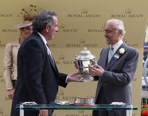 Golfer Sam Torrance presents owner Khalid Abdullah with a trophy after winning the Tercentary Stakes during day three of the Royal Ascot meeting at Ascot Racecourse, Berkshire. PRESS ASSOCIATION Photo. Picture date: Thursday June 20, 2013. See PA story RACING Ascot. Photo credit should read: Steve Parsons/PA Wire