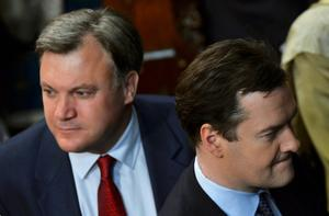 LONDON, ENGLAND - MAY 08:  Britain's Chancellor of the Exchequer George Osborne (R) and shadow chancellor Ed Balls attend the State Opening of Parliament on May 8, 2013 in London, England. Queen Elizabeth II unveils the coalition government's legislative programme in a speech delivered to Members of Parliament and Peers in The House of Lords. Proposed legislation is expected to be introduced on toughening immigration regulations, capping social care costs in England and setting a single state pension rate of 144 GBP per week.  (Photo by Toby Melville - WPA Pool/Getty Images)