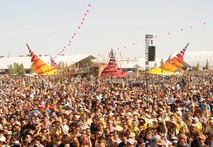 INDIO, CA - APRIL 12:  Music fans watch the band Stars perform onstage during day 1 of the 2013 Coachella Valley Music & Arts Festival at the Empire Polo Club on April 12, 2013 in Indio, California.  (Photo by Kevin Winter/Getty Images for Coachella)