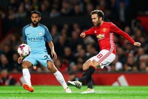 Juan Mata of Manchester United (R) shoots during the EFL Cup fourth round match between Manchester United and Manchester City at Old Trafford on October 26, 2016 in Manchester, England.  (Photo by David Rogers/Getty Images)