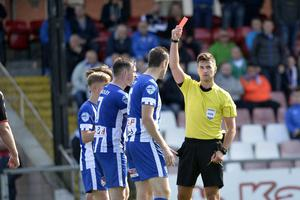 Coleraine's David Ogilby gets a red after getting a second booking from referee Ian McNabb.   Photo by Stephen  Hamilton / Press Eye