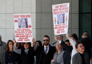 Relatives of Henry Thomas Burke hold posters outside the Hillsborough inquests in Warrington, where the inquest jury concluded that the 96 Liverpool fans who died in the Hillsborough disaster were unlawfully killed. PRESS ASSOCIATION Photo. Picture date: Tuesday April 26, 2016. See PA story INQUEST Hillsborough. Photo credit should read: Joe Giddens/PA Wire