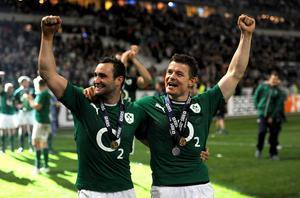 Ireland's Brian O'Driscoll and Dave Kearney (left) celebrate after the Six Nations match at the Stade de France, Paris, France.