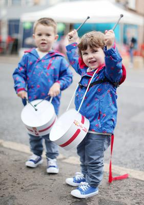 Press Eye - Belfast -  Northern Ireland - 13th July  2015  Belfast's Orange Order annual 12th of July demonstration makes its way through the City Centre to the field at Malone House beside Shaws Bridge.  Brothers Roman(3&left) and Reuben McKinney(2) from Templepatrick play the drums as they want for the parade on the Lisburn Road.   Picture by Jonathan Porter/Press Eye