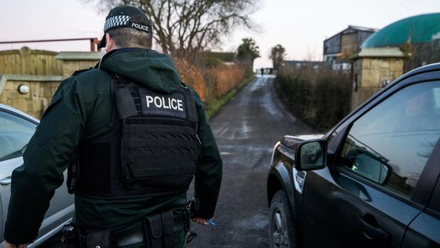 PSNI officers raiding a property as part of one of the largest money laundering operations in Northern Ireland (Liam McBurney/PA)