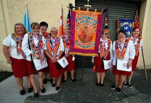 Orangewomen are pictured taking part in the annual July 12 parade in Belfast, on July 12, 2017. July 12 is the main marching day in the Orange Order calendar. The parades mark the Protestant commemoration of the 327th anniversary of King William III's victory at the Battle of the Boyne in 1690. / AFP PHOTO / Paul FAITHPAUL FAITH/AFP/Getty Images