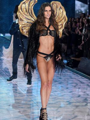 NEW YORK, NY - NOVEMBER 10:  Model Izabel Goulart from Brazil walks the runway during the 2015 Victoria's Secret Fashion Show at Lexington Avenue Armory on November 10, 2015 in New York City.  (Photo by Jamie McCarthy/Getty Images)