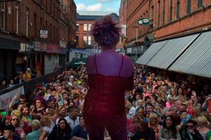 BELFAST, NORTHERN IRELAND - AUGUST 1:  Drag artiste Glitzy Glamour performs on stage in Union Street as thousands of participants and supporters take part in the 25th annual Belfast Pride parade on August 1, 2015 in Belfast, Northern Ireland. Same-sex marriage whilst legal in the United Kingdom is still not recognised in Northern Ireland despite repeated votes on the issue. The governing Northern Ireland Executive has stated that it does not intend to introduce legislation allowing for same-sex marriage in Northern Ireland.  (Photo by Charles McQuillan/Getty Images)