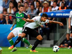 PARIS, FRANCE - JUNE 21: Oliver Norwood (L) of Northern Ireland and Sami Khedira (R) of Germany during the UEFA EURO 2016 Group C match between Northern Ireland and Germany at Parc des Princes on June 21, 2016 in Paris, France. (Photo by Charles McQuillan/Getty Images)