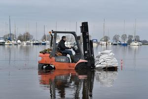 © Press Eye - Belfast - 6th January 2016. Business' flooded at Kinnego Marina, Craigavon as Lough Neagh rises. Paul Quinn of South Shore Marine ferries more sandbags to stem the rising water. Photo by TONY HENDRON/Presseye.