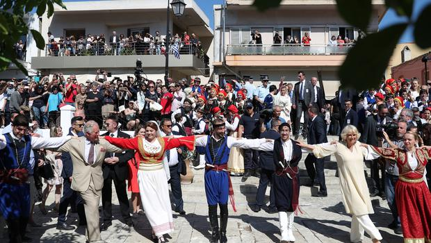 They had a dance during a tour of stalls showcasing Cretan produce, crafts, local initiatives and entrepreneurs (Andrew Matthews/PA)