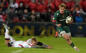 Matthew Tait of Leicester Tigers runs away from a tackle by Luke Marshall of Ulster during the European Rugby Champions Cup Pool 3 match between Ulster Rugby and Leicester Tigers at the Kingspan stadium. (Photo by Charles McQuillan/Getty Images)