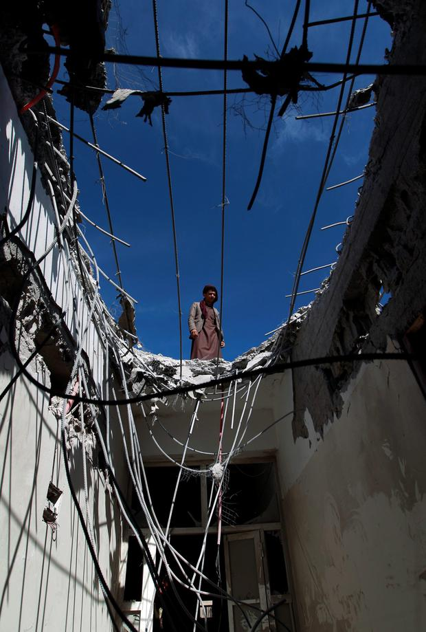 A Yemeni worker looks at the damage at the Noor Centre for the Blind after it was reportedly destroyed by Saudi-led air strikes in the capital Sanaa on January 5, 2016. AFP/Getty Images