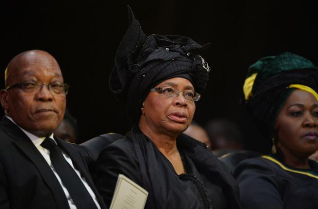 Nelson Mandelas widow Graca Machel sits in-between South African President Jacob Zuma and his wife Bongi Ngema during the funeral service for former South African President Nelson Mandela in Qunu, South Africa, Sunday, December 15, 2013. (AP Photo/Odd Andersen, Pool)