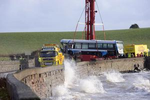 Pacemaker Press Belfast 09-12-2015: Newtownards, County Down: Bus lands on beach following crash. A bus has landed on a beach after crashing on the Portaferry Road near Newtownards, County Down. The driver of the Ulsterbus sustained minor injuries in the incident which happened at about 06:30 AM on Wednesday. The operation is under way to recover the vehicle. Picture By: Arthur Allison.