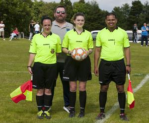FEMALE OFFICIALS. . . .Hughes Insurance Foyle Cup Press Officer Dermot Liddy pictured with the officials at Thursday's game between Foyle Harps and Arklow Town FC which included two ladies. From left are Sarah Dyas, Megan Power and Omesh Debipersad. FC04-M1-06