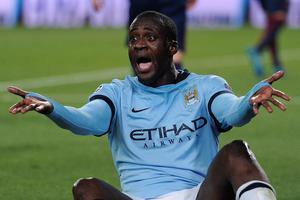 Manchester City's Ivorian midfielder Yaya Toure shouts during the UEFA Champions League round of 16 football match. AFP/Getty Images