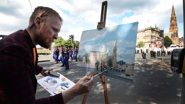 Pacemaker Press 12/7/2017 A local Artist records the The 12th of July Parade which  takes place from from Clifton Street threw the streets of Belfast on Wednesday, As thousands of people line the streets across Northern Ireland the 12th of July celebrations. Pic Colm Lenaghan/Pacemaker