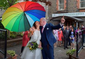 Newly married couple Anne Fox (nee Cole) and Vincent Fox kiss to celebrate their wedding and also show their support for the Yes campaign in favour of same-sex marriage before casting their votes at a polling station on May 22, 2015 in Dublin, Ireland. (Photo by Charles McQuillan/Getty Images)
