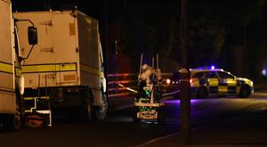 Police and ATO at the scene of a security alert on the Lurgan Road near Maple Park in Crumlin , Co Antrim on Thursday evening, A number of homes have been evacuated. Pic Colm Lenaghan/Pacemaker