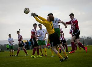 Carniney Youths goalkeeper Daniel McNicholl punchs clear to safety against Donegal Schoolboys in Thursday's u-14 Hughes Insurance Boyle Cup clash at Leafair, Derry. FC04-M2-06