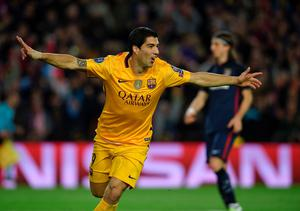 Barcelona's Uruguayan forward Luis Suarez after scoring a goalduring the UEFA Champions League quarter finals first leg football match FC Barcelona vs Atletico de Madrid at the Camp Nou stadium in Barcelona on April 5, 2016. / AFP PHOTO / LLUIS GENELLUIS GENE/AFP/Getty Images