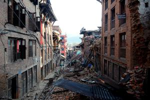 "Collapsed houses in Bhaktapur, on the outskirts of Kathmandu, are seen on April 27, 2015, two days after a 7.8 magnitude earthquake hit Nepal. Nepalis started fleeing their devastated capital on April 27 after an earthquake killed more than 3,800 people and toppled entire streets, as the United Nations prepared a ""massive"" aid operation.  AFP PHOTO / PRAKASH MATHEMAPRAKASH MATHEMA/AFP/Getty Images"
