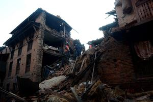 "Rescue personnel search for survivors amidst the rubble in Bhaktapur, on the outskirts of Kathmandu, on April 27, 2015, two days after a 7.8 magnitude earthquake hit Nepal. Nepalis started fleeing their devastated capital on April 27 after an earthquake killed more than 3,800 people and toppled entire streets, as the United Nations prepared a ""massive"" aid operation.  AFP PHOTO / PRAKASH MATHEMAPRAKASH MATHEMA/AFP/Getty Images"